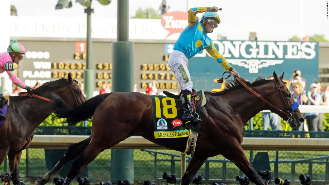 Jockey Victor Espinoza celebrates after American Pharoah crosses the finish line to win the Derby.